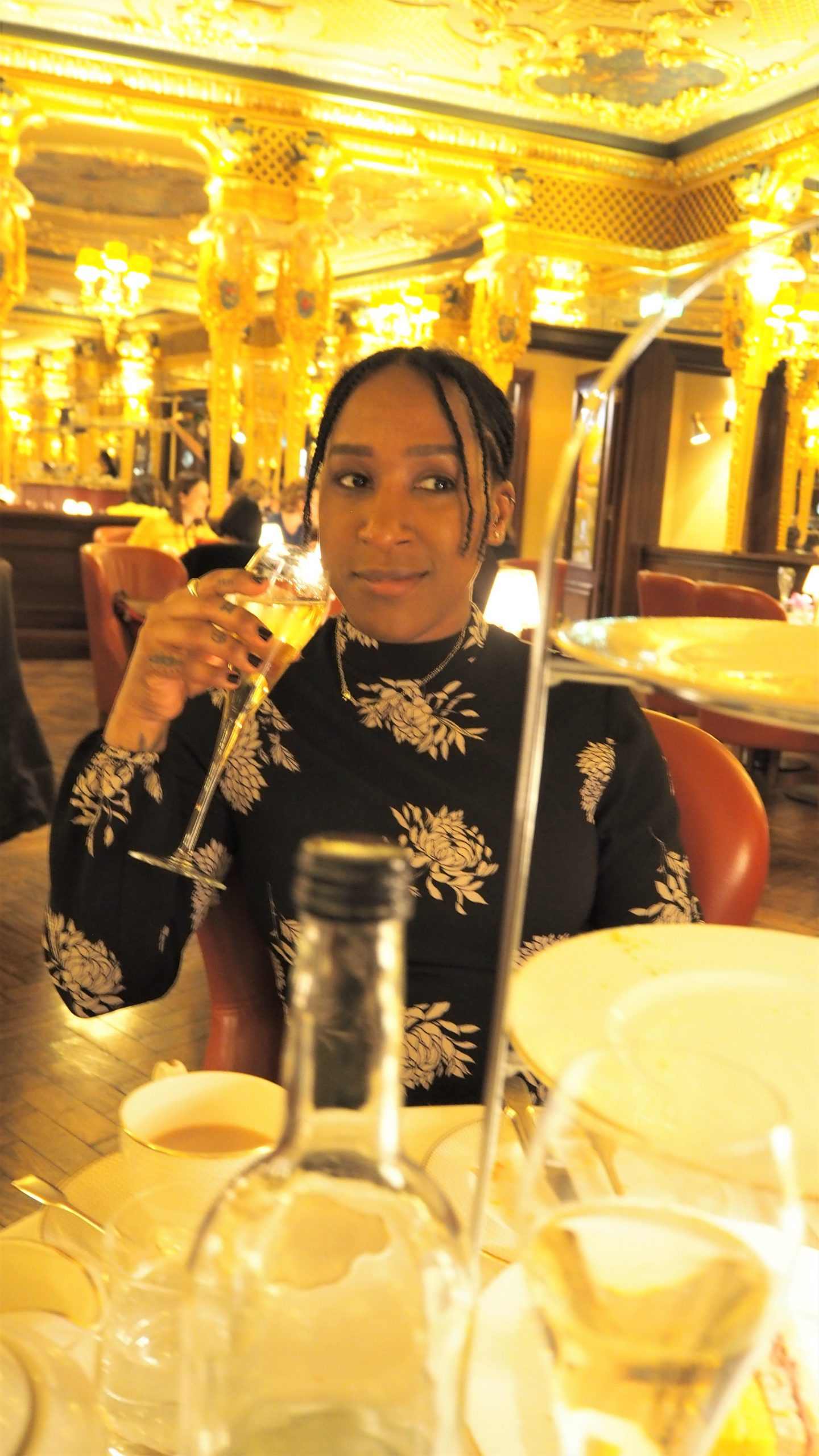 juanita likes drinking champagne hotel cafe royal